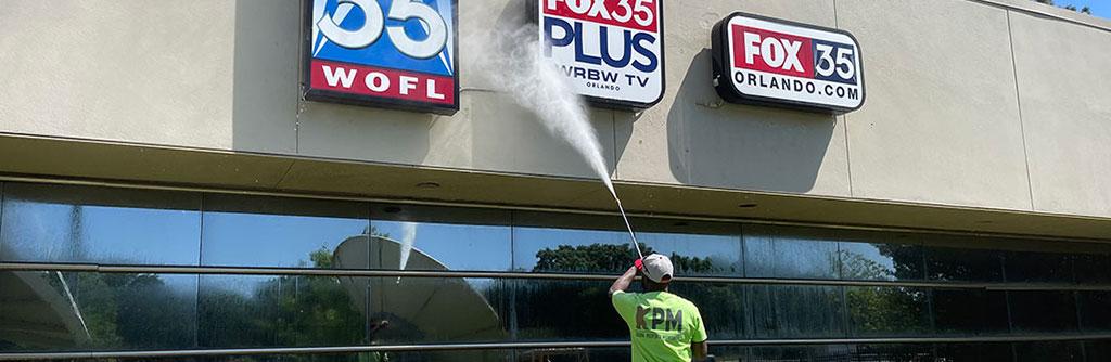Kodiak Property Maintenance-Pressure Washing FOX 35 Building
